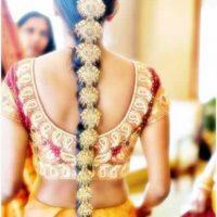 peinado con flores para novia estilo india
