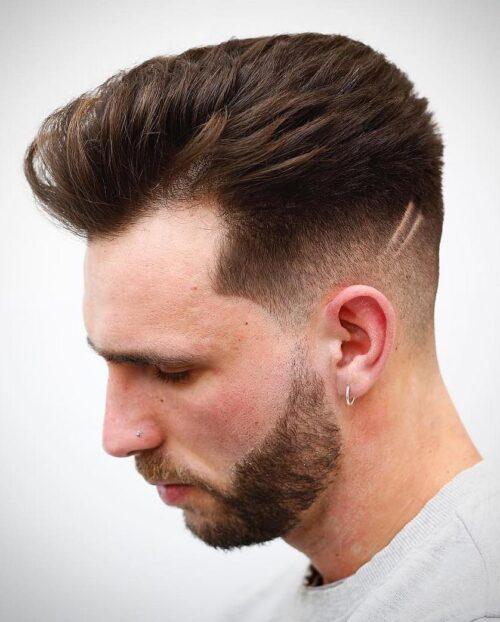 corte low fade para hombre con decoración rayas
